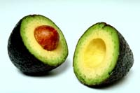 Avocados are good for lowering cholesterol: Picture of an avocado cut in half.