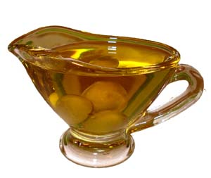 Small jug with olive oil.