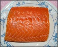 Raw salmon steak.