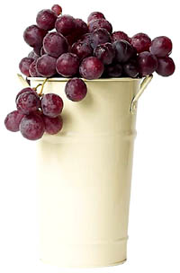 Grapes are great as cholesterol lowering foods: Red grapes in a white metal bucket.