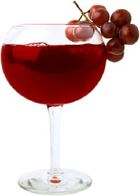 Red wine is also a type of food to lower cholesterol: Photo of glass of red wine with red graps .