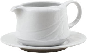 Fat cream is an example of high cholesterol foods: Picture of white cream pitcher.