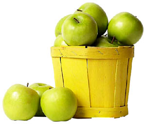 Green apples as low cholesterol foods: Fresh apples in a yellow wooden bucket.