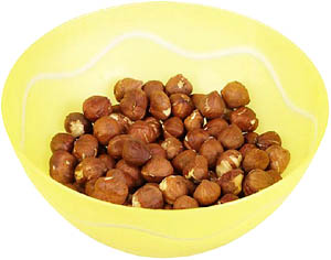 Hazelnuts are good cholesterol foods: Nuts in a yellow bowl.