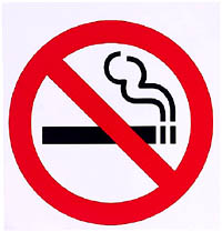 Avoiding high cholesterol symptoms: Quit smoking. Picture of a non smoking sign.