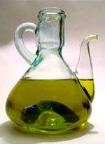 Lower cholesterol naturally by eating olive oil: Photo of olive oil in a bottle.