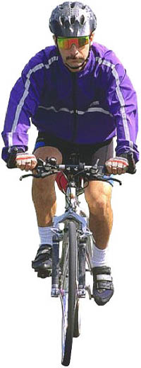 Exercise is one of the best answers to the question of how to lower your cholesterol naturally: Photo of man on a bike.